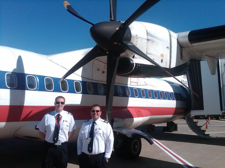 Owners Logan and Jason in front of American Eagle ATR-72